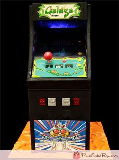 Believe it or not, that's not a Galaga Arcade Game.   That's a cake!
