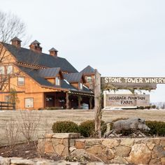 Stone Tower Winery has a rustic, log cabin vibe with hand-painted signs and stone landscaping. Leesburg, VA