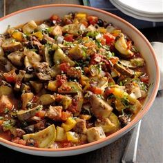 Slow Cooker Ratatouille Recipe -Not only does this classic recipe make a phenomenal side dish, you can also serve it with sliced French bread for a warm and easy appetizer. Try it in the summer with your garden-fresh vegetables. —Jolene Walters, North Miami, Florida