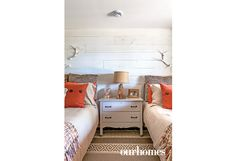 "A chest of drawers and a bed from a sister's cottage, matched with a similar bed bought at a sale, furnish another downstairs bedroom.   See more of this home in ""Cottage Blends Memories with Eclectic Styling"" from OUR HOMES Muskoka Fall 2016 http://www.ourhomes.ca/articles/build/article/cottage-blends-memories-with-eclectic-styling"