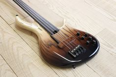 F Bass - Handmade Bass Guitars vertically Brown Bursted BNF4 with Maple fret lines, a single magnetic pickup in the bridge position, and Piezo saddle pickups.