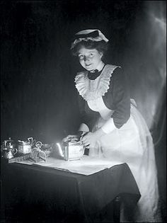 Victorian maid polishing the silver.