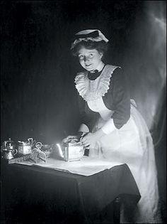 Victorian maid polishing the silver