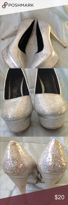 "Promise Silver Taboo Platform Pumps This shoes is glitzy with a iridescent silver sparkly color which changes as you walk. 1 1/2"" platform and 5 1/2"" heel Promise Shoes Heels"