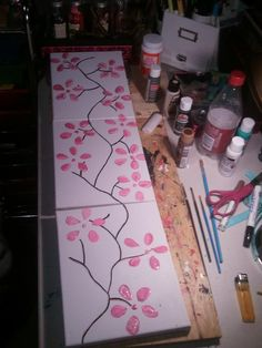 $3 to make. I used 3 canvas's...paint pens for the stem (black and gold) and 5 different colors of pink paint for the flowers. I tried using the bottom of a pop bottle for the flowers (saw that on pinterest) but it didnt come out that good so i painted over them and it was easy. I loved making them and i will def. be doing more! :-) ---Mary Lollini