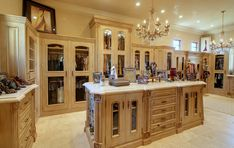 """When some extra space became available, the wife's boutique-like closet swallowed it up. """"She likes to keep everything very tidy and organized,"""" says Fratantoni. The counters are marble, and the floor is travertine with a smooth finish."""