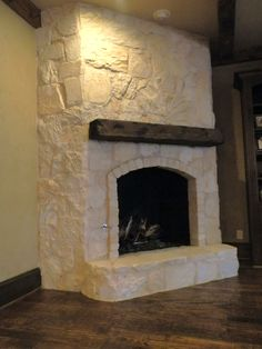 This fireplace received an Austin stone facelift. Designer Susan Mock selected a sample of limestone that had subtle color shifts and minimal contrast in the grout. It was a breath of fresh air in the once dark family room.