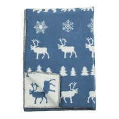 The Wilderness childrens blanket by Klippan Yllefabrik is designed by the illustrator Emelie Ek. It's made in high quality lambs wool and has a lovely pattern with reindeers, firs and other symbols that bring thoughts to the north of Sweden. Perfect for chilly winter walks with the pram!