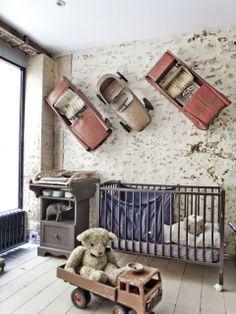 Baby room--industrial look, brick, stone, wood. Vintage kids cars mounted on wall.