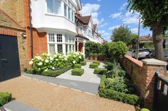 See this example of a recent garden design in Barnes, West London, from Harrington Porter, garden designers and landscapes in Narrow Garden, Back Garden Design, West London, Back Gardens, Madrid, Sidewalk, Garden Ideas, Mansions, Landscape