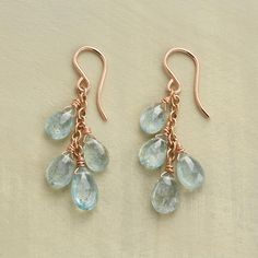 """AQUAFALL EARRINGS--Aquamarine droplets flecked with slate gray tumble from 18kt rose vermeil links on French wires to match. Handcrafted in USA exclusively for Sundance. 1-1/2""""L."""