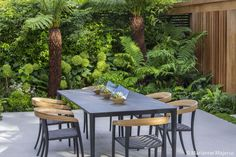 Matt Keightley and the team at Rosebank were tasked with transforming this space into a slice of 'calm in the city' for the clients to both relax and entertain. What was once a dilapidated garage used for storage has been transformed into a private hot-tub haven with bespoke iroko joinery masking the previous unsightly structure. … Tropical Backyard Landscaping, Tropical Garden Design, Small Garden Design, Garden Landscape Design, Tropical Gardens, Landscaping Ideas, Garden Ideas Uk, Garden Images, Garden Inspiration