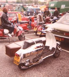Lambretta with coffin sidecar and chrome panels