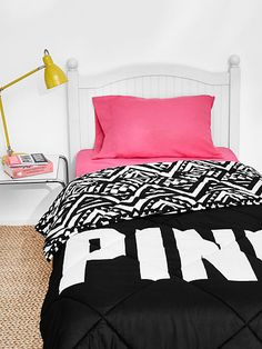 "Bed in a Bag PINK set  Black Aztec/Pink (CL1) Move-in day made easy thanks to this all-in-one bed set. Comes with a reversible comforter, sheet set and pillow cases. In cute colors and prints to deck out your dorm room or bedroom. Only from Victoria's Secret PINK. Queen comforter: 84"" x 88"" Queen flat: 90"" x 102"" Fitted: 60"" x 80"""