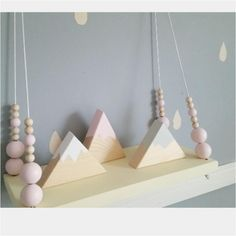 Wooden mountains will make a beautiful decoration in your child's playroom, bedroom, nursery.They are made of pine wood wood which comes from a sustainable source and hand painted with non toxic, water based paint. They are sealed with natural beeswax All sides of the mountains are painted.Colours: black, white, baby pink, pink, yellow, blue, dark blue, light grey, dark grey, lilac, mint green.CHOOSE YOUR OWN DESIGN SCHEME - Please specify design you would like your set to have - please…