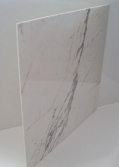 Marble Veneer?  I wonder what kind of quality this is, and how it looks and performs….  It has to be less expensive than the Carrara I've used and am so fond of.