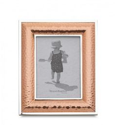 This hammed copper picture frame, has a stunning textured detail that makes it slightly modern and industrial. Copper accents are very in for 2014!