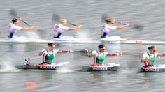 Belarus' Nadzeya Papok, Volha Khudzenka and Maryna Pautaran and (R-L) Great Britain's Jess Walker, Rachel Cawthorn and Angela Hannah compete in the kayak four (K4) 500m women heats during the London 2012 Olympic Games, at Eton Dorney Rowing Centre in Eton, west of London, on August 6, 2012.