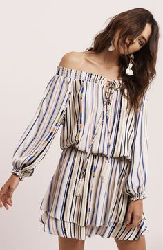 Perfect for days at the beach and evenings out, this breezy blouson dress has an off-the-shoulder neckline and cinched waist.