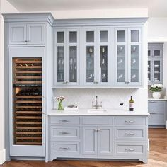 Blue Gray Butler Pantry Cabinets with Light Gay Arabesque Tiles