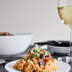 Roasted Sweet Potato Risotto Recipe Main Dishes, Side Dishes with sweet potatoes, nutmeg, smoked paprika, salt, pepper, olive oil, unsalted butter, shallots, garlic cloves, arborio rice, dry white wine, vegetable stock, grated parmesan cheese, brown butter, bacon, chopped fresh herbs