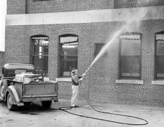 E.L. Tripp sprays DDT around the Livestock Exchange building to control the fly population on May 17, 1947. Many other areas in the yards and buildings around were sprayed to control the loss of livestock caused by the flies. MARTIN KOTRBA/THE WORLD-HERALD