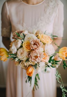 Peach and yellow bouquet by Jardine Botanic. Photo by Mitch Pohl (via Hello May).