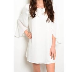 White V-back flowy dress Just in! White chiffon with low-back v and zipper closure. Lining and fabric are both 100% polyester. Please indicate your size when purchasing. April Spirit Dresses Wedding