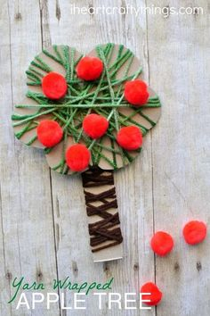 This yarn wrapped apple tree craft works fine motor muscles for toddlers and preschoolers and is a great apple craft for preschool and fall kids craft.