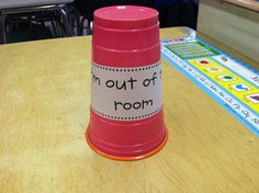 When kids are pulled for speech, OT, reading groups, etc., they put the cup on their desk  to say they are out of the room.  It makes it easy to glance around the room and see who has been pulled.