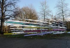 Thames Path west London: racing rowing boats in racks Thames Path, West London, Rowing, Paths, Boat, Dinghy, Boating, Boats, Canoeing