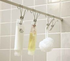 Hooks on a shower curtain rod are a minimalist way to store your bath toiletries.