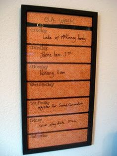 Photo frame with scrapbook paper under glass, write on with whiteboard marker. Cute idea for looking at the weekly family schedule. More space for detail than a monthly calendar...