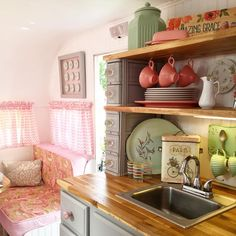 The kitchen nook of sister on the fly Michelle's vintage Serro Scotty. I love the old sewing machine drawers.  @shelleash #camplikeagirl #vintagetrailer #serroscotty