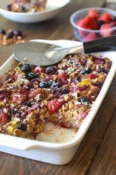 Healthy Baked Honey Berry Oatmeal. This recipe is super filling and perfectly sweet! Only 310 calories for a HUGE slice!
