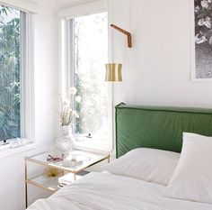white bedroom + green velvet headboard