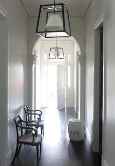 Cameron Kimber - entrances/foyers - long halls, long hallways, hall lanterns, hallway lanterns, iron lanterns,  Long hallway accented with a...