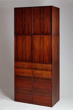 Mogens Koch; Rosewood and Mahogany Modular Cabinets for Rud Rasmussen, 1950s.