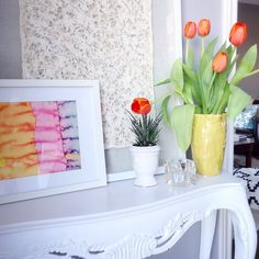 Fresh orange tulips and art