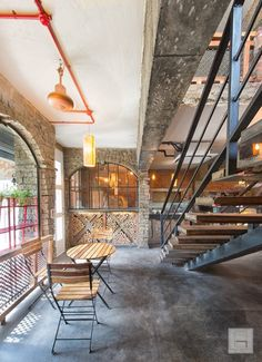 Unconventional Cafe Interior Adding Rustic Flavor To Space | Praveen Architects - The Architects Diary Exposed Brick Walls, Exposed Concrete, Coffee Cup Cafe, Stair Well, Restaurant Interiors, Brickwork, Cafe Interior, Decorating Tips, Architects