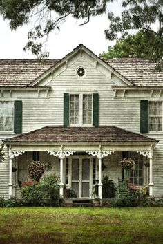 On the opposite side of barn stood the old two-story farm house, worn out a little throughout the years. The color had begun to fade long ago but it still stood beautiful with it's delicate Victorian trim.  Green shudders framed the windows.  On the porch she could see her dad with a cup of coffee in his hand.