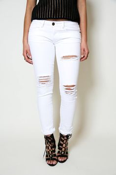 The Destroyed Denim by Machine Jeans are the must have staple jeans. They are low rise, skinny jeans, with ripped details at the knees and thighs and a 5 pocket design. They easily go with everything
