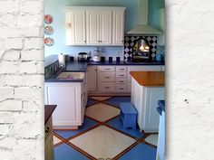 Design idea for painting the floor - I'd use far more subtle colors for my kitchen though. Maybe a dark grey and a light grey, lined with black or white... hmmmm do many options!