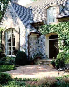 CURB APPEAL – another great example of beautiful design. Brick & stone exterior.