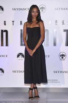 Chic: Zoe Saldana once again wowed the fashion police as she stepped out in a chic black sun-dress in Mexico City for the Strek Trek Beyond photocall on Tuesday