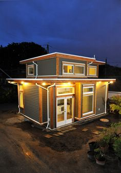Brendon and Akua live in Vancouver in a charming tiny house that they built with the help of Smallwo. The 500 square foot home was built behind Brendon's parent's home and features a ga Tiny House Movement, Tiny House Living, Small Living, Living Area, Living Room, Best Flooring, Cabins And Cottages, Tiny Cabins, Tiny Spaces