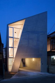 House Folded, designed by by Kyoto-based architecture practice Alphaville, is a three-story residence in Osaka, japan. The concrete structure sits on a a thin site measuring 80 m². Inside the spatially dynamic volumes, the folded dividing walls are defined by a triangular slit that pierces through its front and rear facades which brings in light and spatial continuity between the indoor and the outdoor.