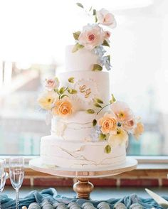 created this incredible confection, which featured layers of sea salt caramel, raspberry-lemon, and strawberry cake. 🎂 It was adorned with realistic sugar flowers—insect nibbles and all—and an edible version of the couple's monogram. Pastel Wedding Cakes, Summer Wedding Cakes, Cool Wedding Cakes, Beautiful Wedding Cakes, Wedding Cake Designs, Beautiful Cakes, Wedding Tables, Purple Wedding, Gold Wedding