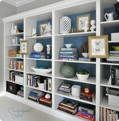 add moulding to Ikea bookshelves and paint the backs {build three self units so it sits lower}