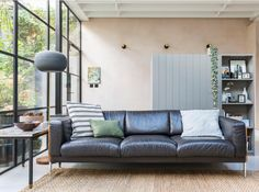 Mid-century leather sofa as seen on Grand Designs South London old dairy conversion